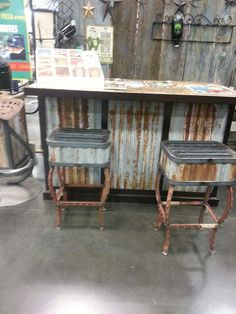 Fence stakes and corrugated metal siding to make bar stools and a bar. Great repurposing/recycling.