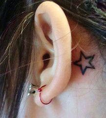Behind the ear tattoo... Pretty, soft, feminine :) maybe a Japanese symbol?