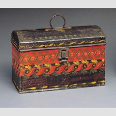 """TRUNK/ North Shop (act. c. 1790–1841); paint decoration attributed to Mercy North (1798–1872) Fly Creek, New York, c. 1815–1825, paint on asphaltum over tinplate, 5 1/2 × 8 9/16 × 4 9/16"""", gift of the Historical Society of Early American Decoration, courtesy Elizabeth B. Swain, collection American Folk Art Museum, 76.10. Photo credit: John Parnell."""