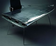 An airplane wing for a desk - now that is cool! Although my pencils might roll off!