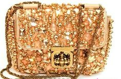 This Golden Bag _ is more luxurious, and it consists of many bead and sequin, which can attract people's eyes at the first glance. You can choose this one to show your tastes and to show your status and thus to make you superior. _ The Trend of Chloe Handbags 2011
