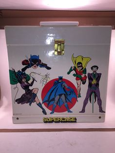 This is a Marvel Characters Supercase from 1977. These cases were designed to fit LP records or as a carrying case for you action figures. This case has great graphics of the Batman characters on one side and Superman, Supergirl and Wonder Woman on the other. The case is in great shape except for the vinyl splitting on the inside of the top were the hinge is. This is the larger of the two Supercases that were made. This one is about 12 x 12 inches.