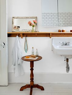 Outfitted with hooks, a cherry shelf adds storage.