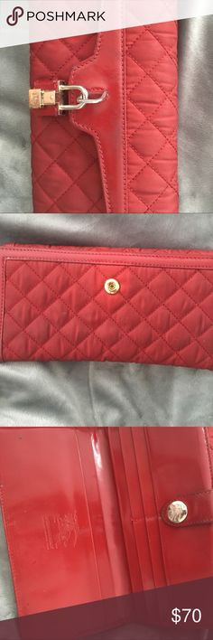 Red Burberry wallet Authentic. Overall clean and in good condition, there is some minor color fading in guessing from rubbing it on dark clothes. The lock that is picture has some minor scratches. Not sure if it can be placed in washer or cleaned with spot/stain remover Burberry Accessories