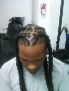 Dreadlock style: He's just chillin with braided dreadlocks.