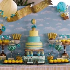 Amazing hot air balloon baby shower! So cute and blue and yellow are the perfect gender neutral combo.