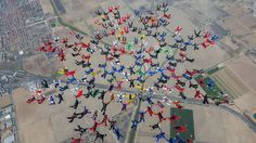 Skydivers link together above Perris, California, on Tuesday, September 9. They set a world record for largest sequential skydiving formation (202 skydivers).