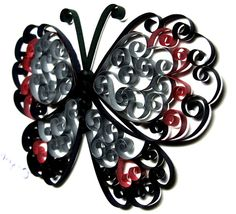 Quilled butterfly made with metallic paper.