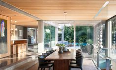 Eppich House Renovation by Battersby Howat Architects | Photo © Sama Jim Canzian wood and concrete interior - dining room http://www.woodz.co/eppich-house-renovation-in-west-vancouver/