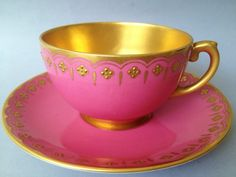 19th CENTURY JEWELED COALPORT china pattern bright pink outside color and bright gold color is inside color tea cup