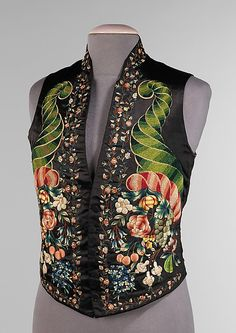 1845–59 Vest. The elaborate embroidery pattern on this vest is well designed and rendered with heavily textured cornucopias next to delicate flowers in ombréd tones to add depth and realism. Vests of the 18th and 19th centuries were seen as a vehicle of self-expression, much as a necktie is seen today. This particular vest, with its cornucopias symbolizing abundance and fulfillment, was inspired by the intricate embroidered waistcoats of the previous century.