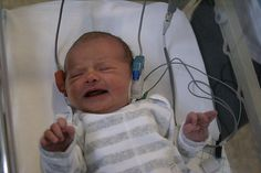 Sweet baby, dont cry! Hearing is very important!!