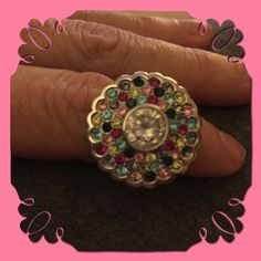 Stunning flower colored gemstone silver ring I bought this ring in Puerto Rico a couple years ago and i love it. I get lots of compliments when worn. Sparkles like no other ring. Colored gemstones against silver catches the eye. Grab this fast! Jewelry Rings