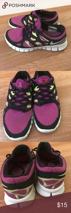 Nike free run 2 wo's size 7 Nice slight tear on front of right shoe as seen on pictures Nike Shoes Athletic Shoes