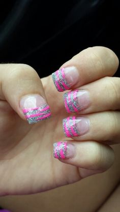 Silver acrylic tips with hot pink zebra stripes!