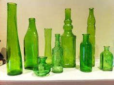 Selling 33 green bottles for $105.00. Could be used as centerpieces, etc. I like them but don't want to buy 33, lol.