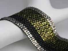 Peyote Stitched Cuff..Incredible job...I don't think you can get any better so just keep doin' what you are doin' *SMILES*