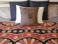 Beautiful old sarees recycled into Katha Throws used as a bed cover