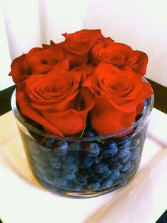 Another great use for Valentine's flowers! Mix flowers and fruit with colors that complement each other.
