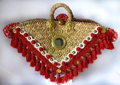 The Sicilian are bags obtained by the skilful weaving of the leaves of the Sicilian dwarf palm. Embellished with mirrors, fabrics, etc. They are capacious, resistant and since they have been chosen as an accessory for some designer such as and All African Babies, Coral Jewelry, Red Bags, Textiles, Coral Turquoise, Beige Color, Handmade Bags, Straw Bag, Designer