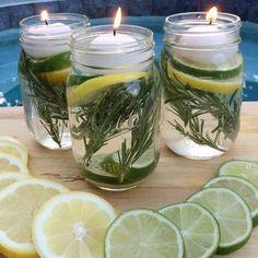 Tegen de muggen én decoratief! Limoen, citroen, rozemarijn, water en drijvende theelichtjes.
