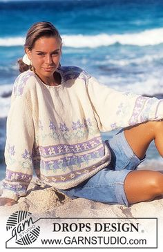 """DROPS 30-10 - DROPS jumper with pattern borders in """"Paris. Size S – L. - Free pattern by DROPS Design"""