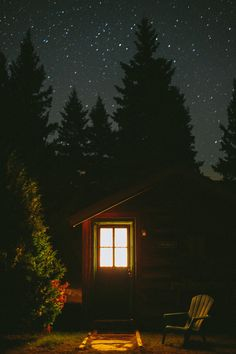 The Marcy Cabin at night under a starry sky at Mt. Van Hoevenberg Bed and Breakfast, Lake Placid NY. by Hendrickson Photography