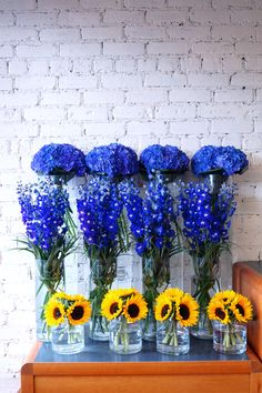 These were for a corporate event today, we used stunning blue hydrangea, delphiniums and sunflowers, just arranged simply in individual vases, sometimes this looks better than a large mixed arrangement, we think it works well with these flowers. ‪#‎reidsflorists‬ ‪#‎summerflowers‬ ‪#‎corporateflowers‬