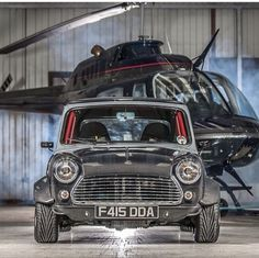 Classic Mini Cooper with black helicopter