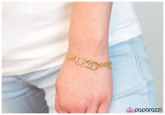 Infinite Thrills - Gold ~ Streams of dainty chain-links give way to a charm of three overlapping infinity symbols. The elegant crisscrossing design captures the eye with its sleek gold design. Features an adjustable clasp closure.