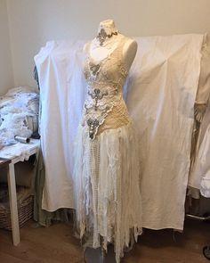 Love the corset back https://www.etsy.com/listing/189242808/alternative-wedding-dressunique-gown