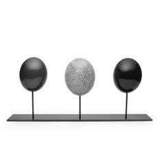 African Luxe trio of Ostrich eggs in grey. These exquisite ostrich eggs are dyed in a grey palette and mounted on a handsome display stand.Handmade in South Africa. Did you know one ostrich egg is the equivalent of 9 chicken eggs, serving a whole family at breakfast!
