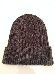 The blend of cables and ribs make this an attractive, unisex hat that is relatively quick to make.