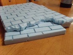 """Easy, cheap way to make """"brick"""" walls using styrene insulation foam. Stage Set Design, Church Stage Design, Prop Design, Theatre Props, Theater, Stage Props, Prop Making, Christmas Villages, Skyrim"""