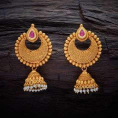 Traditional Designed Antique Hanging earrings studded with Ruby synthetic stones, with gold Polish.