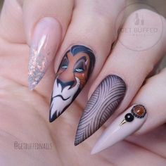 Just die for these  ・・・ Nobody knows the trouble I've seen ⚡️ Scar ⚡️ for all those evil lovers out there! ❤️ and since it's Halloween  @gfa_australia gel colours  @glitter_heaven_australia glitter ❤️ @uglyducklingnails acrylic/matte top  Tag a Lion King fan!  #handpainted #scar #thelionking #disneynails #RP @getbuffednails