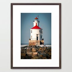 Lighthouse On The Rocks Framed Art Print