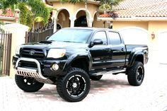 Lifted Toyota Tacoma! Yes!! Just add some Rockstars and change the grill!