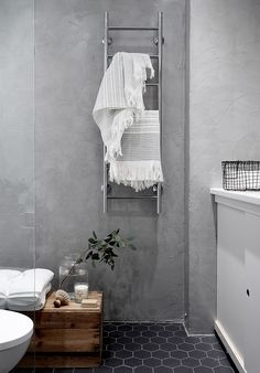 The wood cabinet helps warm things up a little while keeping with the minimalist aesthetic. Concrete wall in bathroom, interior design & styling by Laura Seppänen Budget Bathroom, Bathroom Wall Decor, Bathroom Styling, Bathroom Interior Design, Modern Interior, Small Bathroom, Bathroom Makeovers, Bathroom Layout, Estilo Interior