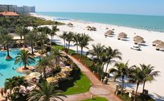 A view of the pool and the beach from my oceanfront room at Marco Island Marriott Resort
