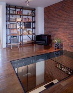 verri re de toit et puits de lumi re dans un duplex dalle de verre dalles et le sol. Black Bedroom Furniture Sets. Home Design Ideas