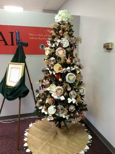 Our tree with ornaments we made from 100% recycled materials!