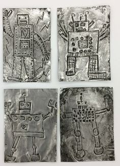 First Grade Metal Tooling Robots - Students used stylus sticks to draw their robots, then painted the entire rectangle with black acrylic. Wiping away the paint by rubbing a paper towel in a circular motion created the antique effect.