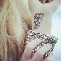 Skull wrist tattoo.... LOVE it