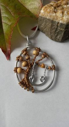 This beautiful tree of life with his little swing pendant was made in aluminum, silver plated wire and Brown, with leaves beige wooden beads. Tree Of Life Necklace, Wooden Beads, Personalized Jewelry, Boutique, Pendant, Silver, Handmade, Etsy, Beautiful