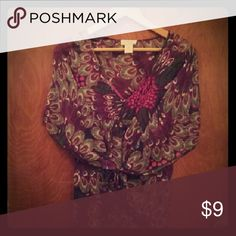 Sheer print blouse with tank top Show off your fabulous self in this beautiful, flowy, sheer top with peacock-feather print. Wear it and work it! Can be tied in the back or front. Also comes with a cute pink tank top already attached underneath. Candie's Tops Blouses