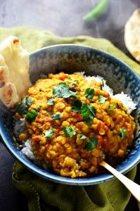 Slow Cooker Indian-Spiced Lentils. This crock pot dahl recipe is hearty, heavily spiced, and ultra-comforting. It doesn't require any crazy techniques, but winds up so flavorful! | hostthetoast.com