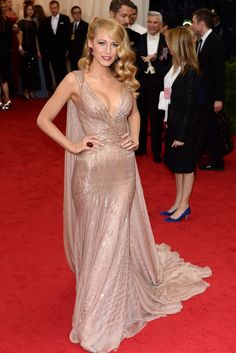 Blake Lively in at the 2014 Met Ball red carpet. Her Gucci dress is one of the Met Gala's most memorable looks.