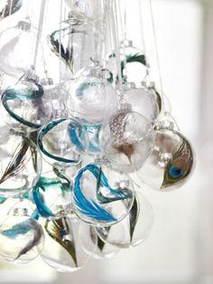Dress up basic clear glass-ball ornaments by filling each with a delicate feather (available at craft shops). For a chandelier-like impact, suspend a cluster from a small hook you install in the ceiling.