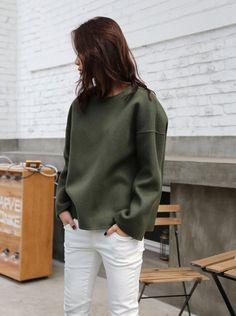 Olive sweatshirt and white jeans
